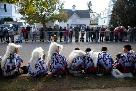 Tibetans in traditional garb were joined by neighbors as they waited to welcome the Dalai Lama to Medford Tuesday.