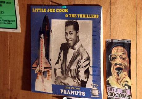 The cover of  Little Joe Cook's 1957 gold record is hanging in his basement studio.