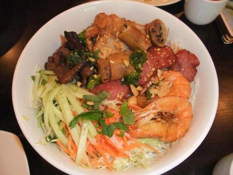 Bun Countryside features grilled meats, seafood, and salad on a bed of vermicelli.