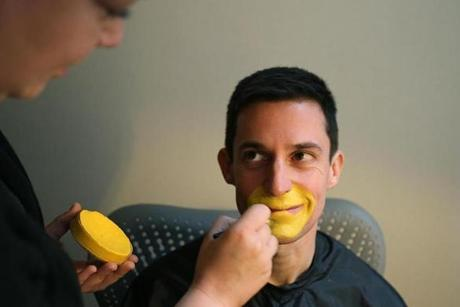 Yellow makeup was applied around his mouth and eyes by makeup artist Alison Wadsworth.