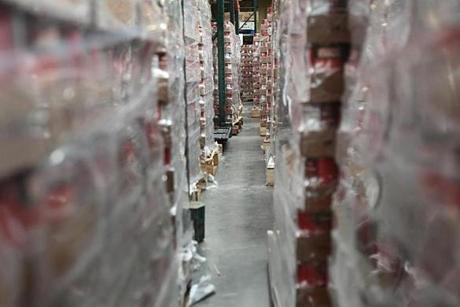 Boston, MA., 10/17/12, Scott Helman chronicles the Greater Boston Food Bank. Scenes inside the Yawkey Distribution Center. Cases of food are organized and stored. Section: Magazine Suzanne Kreiter/Globe staff