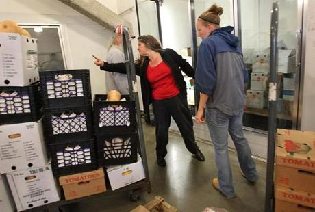 Boston, MA., 10/17/12, Scott Helman chronicles the Greater Boston Food Bank. Linda Malonson, cq , center, of the Stoneham Adventist Community Services, loads up in the Marketplace at the Yawkey Distribution Center. Section: Magazine Suzanne Kreiter/Globe staff