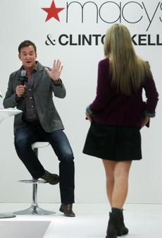 10-18-2012: Peabody, MA: Style expert Clinton Kelly appeared at Macy's North Shore for a fall fashion presentation. Here he describes an outfit that a model is showcasing. section: lifestyle (Jim Davis/Globe Staff)