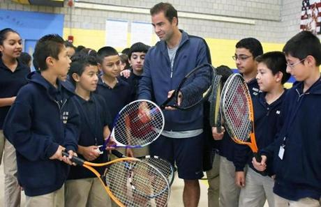 10-19-2012 East Boston, Mass. Students from the Mario Umana Middle School Academy had a special visit from Tennis Star Pete Sampras team up with Tenacity and Staples to benefit Boston Youth, Globe photo by Bill Brett