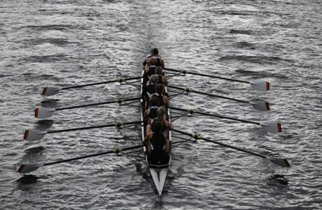 The Charles River was rippling as a women's eight crew pulled through the water as they prepared for the weekend's Head of the Charles Regatta.