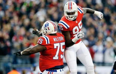 Defensive tackle Vince Wilfork and defensive end Chandler Jones celebrated a safety.