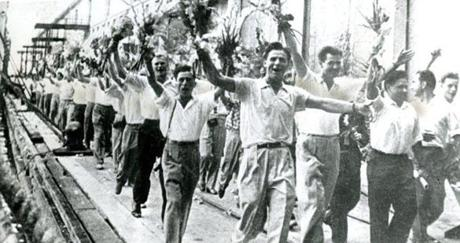 September 27 1962 / Soviet technicians and military men raised their arms and chanted songs as they disembarked in Havanna. This picture was obtained by Bohemia Libre, a Latin American magazine formerly edited in Havanna, but published by Cuban exiles in New York.