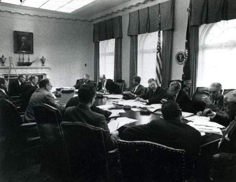 October 1962 / President John F. Kennedy met with his cabinet and advisers during the Cuban missile crisis in the White House on October 1962. From left to right are Robert Kennedy, Attorney General; Llewellyn Thompson, U.S. Ambassador to Russia; Alexis Johnson, Deputy Undersecretary of State; John McCone (hidden), Director of the CIA; George Ball, Undersecretary of State; Dean Rusk, Secretary of State; President Kennedy; Robert McNamara, Defense Secretary; Roswell Gilpatric, Deputy Defense Secretary; Maxwell Taylor, Chairman of the Joint Chiefs of Staff; Paul Nitze, Assistant Defense Secretary; Don Wilson, USIA; Ted Sorenson, Presidential Adviser; McGeorge Bundy (hidden), Presidential Adviser; C. Douglas Dillon, Secretary of the Treasury; Vice-President Lyndon B. Johnson (hidden).