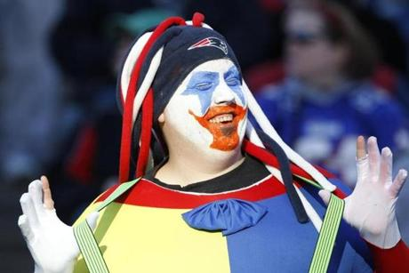 This fan came to the game dressed as a clown.