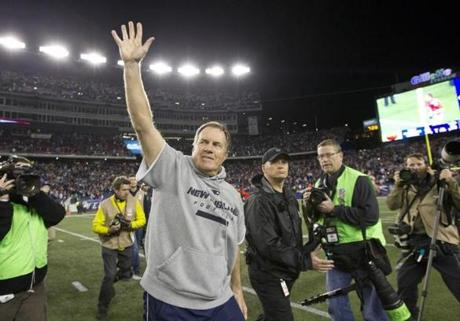 Bill Belichick waved his support to the Foxborough fans before heading back into the locker room.