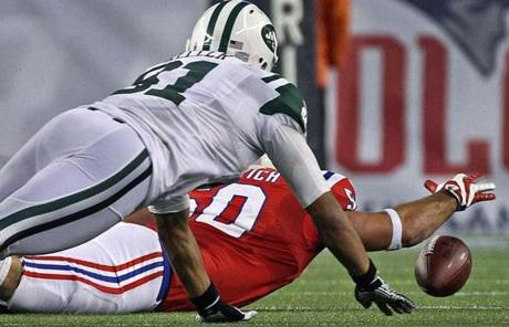 Rob Ninkovich reached for the ball after helping sack Jets quarterback Mark Sanchez in overtime.