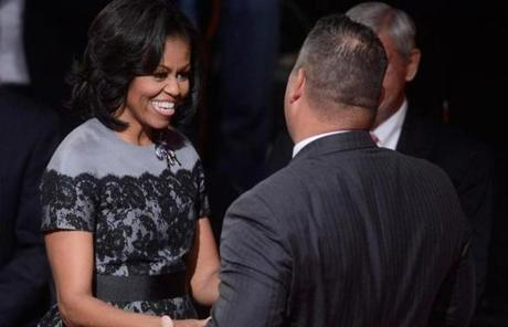 Michelle Obama greeted an attendee at the debate.