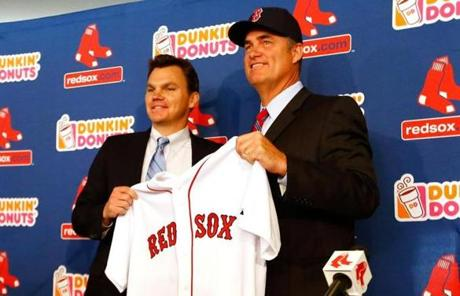 John Farrell, right, took the reins as the new Red Sox manager on Tuesday when he was introduced by GM Ben Cherington.