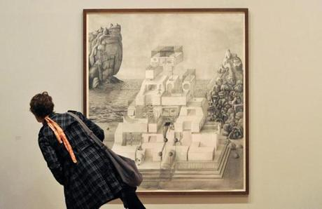 "A visitor reads the description of ""Paul's Palace"" by Turner nominee Paul Noble at the Tate Britain."