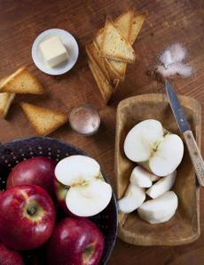 "If you're hopeless at pie pastry, try this deconstructed apple ""pie"" made with thick slices of toasted challah. Cut the bread into triangles, butter it, and toast it in a 375-degree oven for 10 minutes or until lightly browned. Saute wedges of baking apples such as Cortland in plenty of butter, sprinkle with cinnamon and sugar, and spoon over the challah. Top with whipped cream."