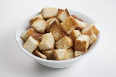 Once you make your own croutons, you'll never go back to the commercial kind. Begin with a 1-pound loaf of unsliced challah (to make 8 cups). Let it sit out for several hours, remove the crusts, and cut the bread into 1-inch cubes. Sprinkle with canola oil and a little salt. Toast in a 350-degree oven for 30 minutes, turning often, until crisp and golden.
