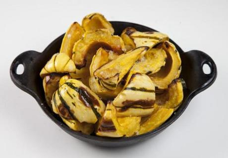 Delicata is one of the best-tasting squashes in the fall harvest and easy to handle. Halve and seed the squash, cut it into irregular triangular pieces, and toss with olive oil, salt, and pepper. Roast in a 400-degree oven for 30 minutes or until tender.