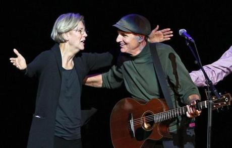 Elizabeth Warren joined singer James Taylor on stage Wednesday night.
