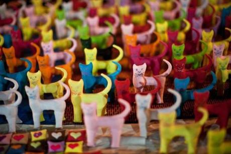 Tiny stuffed cats on display at Luang Prabang's night market.