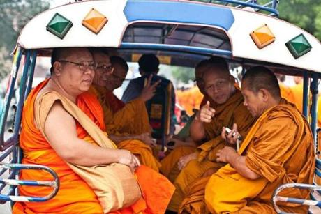 For Travel - 04laos - Monks in a Luang Prabang tuk-tuk (taxi). (Joe Ray)