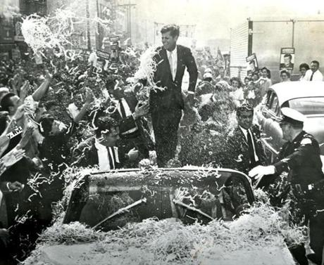 November 1, 1960: Sen. John F. Kennedy is deluged with confetti and paper streamers as his auto moves slowly up Broadway in downtown Los Angeles. It took more than an hour to drive 20 blocks. The Democratic presidential nominee got a frenzied welcome as he began a final quest for California's 32 electoral votes, with one woman throwing herself on the back of his car, scrambling over the trunk and pressing her hand to his check.