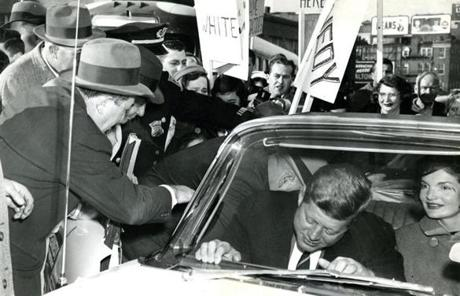 November 8, 1960: After voting at 8:45 a.m. at the West End branch of the Boston Public Library at Cambridge and Lynde Streets, Sen. Kennedy and his wife, Jacqueline leave for the airport to fly to Hyannis. After she voted, Jackie said a bit nervously,
