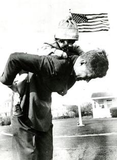 November 9, 1960: President-elect John F. Kennedy gives his daughter Caroline, almost 3, a piggy-back ride during a walk in Hyannis Port as he waits for word that Richard Nixon has conceded the election. He made his acceptance speech at 1:50 p.m. at the National Guard Armory In Hyannis just 65 minutes after Nixon conceded and less than an hour and a half after finally receiving the votes need to put him over the top. It was not until 12:30 p.m. that Minnesota gave him the needed 269 electoral votes.