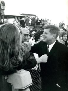 November 11, 1960: Cape Cod hands are extended for a farewell grasp by President-elect Kennedy at Barnstable Airport as he left his Cape Cod home for a working vacation at Palm Beach, FL. Two days before at his acceptance speech, President Kennedy told his Hyannis Port neighbors,