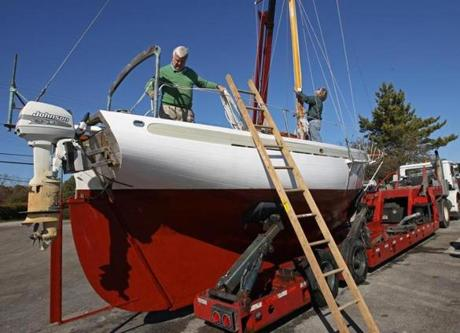 As officials made emergency preparations, George Dow took his sailboat out of Scituate Harbor.