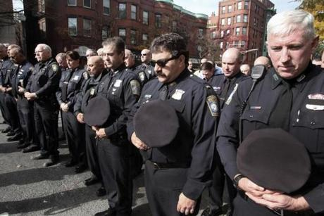Many police officers attended to pay respects.