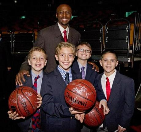 Boston, MA--10/26/2012 Boston Celtics player, Jason Terry (cq) with (l to r) Sam Shuster (cq), 8, Jack Shuster, (cq), 10, Lucas Singer (cq), 10 abnd Oliver Newman (cq), 10, during the Celtics Annual Shamrock Gala to benefit the Boston Celtics Shamrock Foundation at the TD Garden on Friday October 26, 2012 (Matthew J. Lee/Globe staff) Topic: 27celtics Reporter: Mark Shanahan