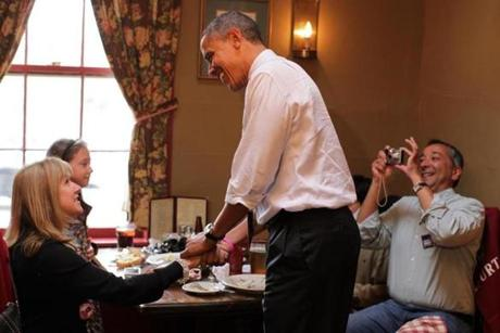 President Obama visited with diners at the Common Man restaurant during a campaign stop in Merrimack, N.H.