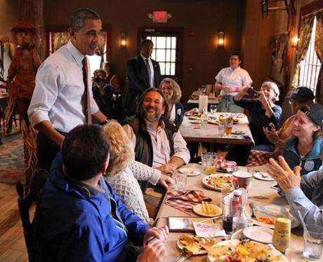 President Obama greeted diners at a restaurant in Merrimack, N.H.