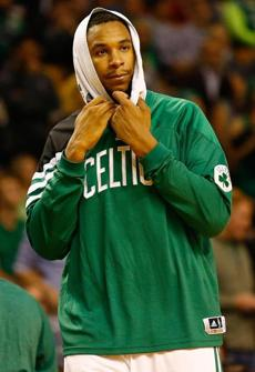 BOSTON, MA - OCTOBER 16: Jared Sullinger #7 of the Boston Celtics watches the game with his head wrapped in a towel during the preseason game against the Brookyln Nets on October 16, 2012 at TD Garden in Boston, Massachusetts. NOTE TO USER: User expressly acknowledges and agrees that, by downloading and or using this photograph, User is consenting to the terms and conditions of the Getty Images License Agreement. (Photo by Jared Wickerham/Getty Images)