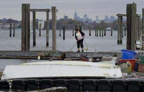 A woman tied lines on a dock in City Island, N.Y.