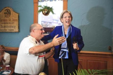 Elizabeth Warren met Fred Rich LaRiccia at a Democratic event in Lynn on Sunday.