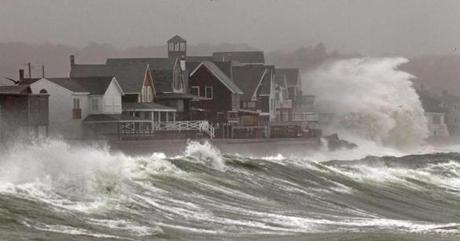 Waves crash over homes on Turner Road in Scituate.