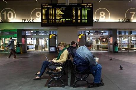 Passengers waited for trains and buses at North Station in Boston on Monday morning.