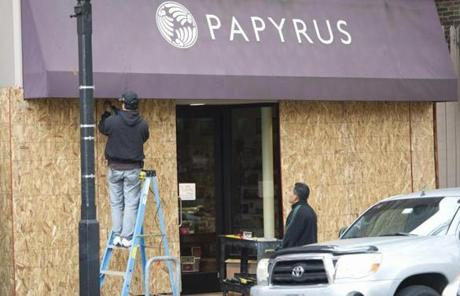 A business owner boarded up his shop in Alexandria, Va.