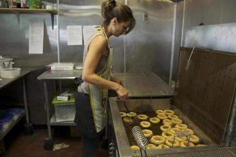 Leigh Kellis, owner of The Holy Donut in Portland, Maine, gets help from her dad.