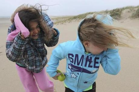 Jillian Webb and Arianna Corso of Dennis walked on Lighthouse Beach in Chatham as Hurricane Sandy pelted them with wind and sand.