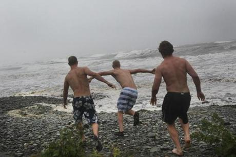The not-so-calm-before-the-storm of Hurricane Sandy. Colin Lincoln, Brennan Lincoln, Guy Matisis, headed into Nantasket Beach for a quick dip before the surf got too big.