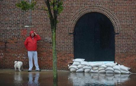 A man walked along a flooded street in Brooklyn.