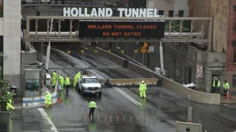 Workers closed the Holland Tunnel in New York.