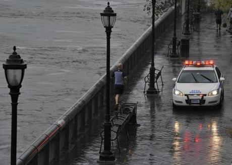 A jogger ran as police closed down an area along East River Drive in New York.