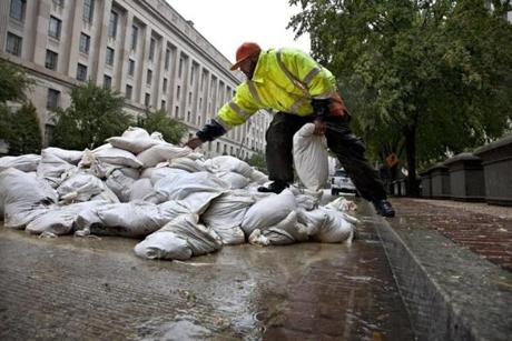 Rick Campbell used sandbags to shore up vulnerable spots at the Old Post Office in Washington, D.C.