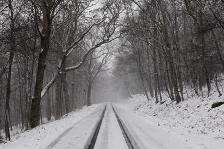 Snow covered Mountain Lake Road at an elevation of 4,000 feet in Giles County, Va.