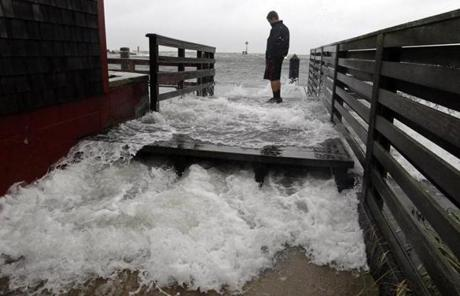 Jamison Orr watched the waves come up through the dock at the Clam Shack in Falmouth Harbor.