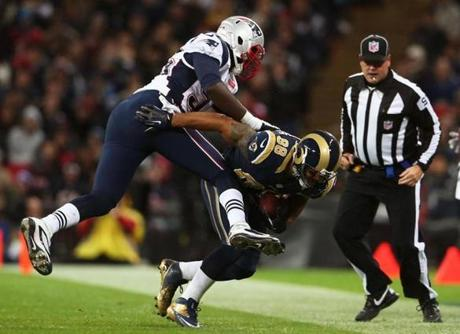 The Rams' Lance Kendricks was pushed out of bounds by Patriots lineman Chandler Jones.