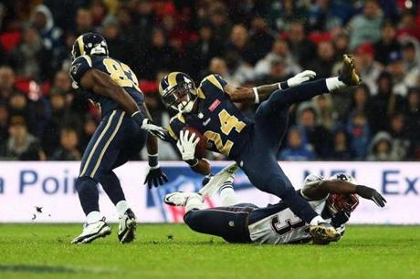 Patriots cornerback Alfonzo Dennard tackled Isaiah Pead of the Rams.